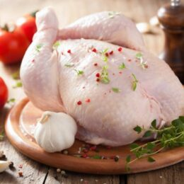 depositphotos_48590785-stock-photo-whole-raw-chicken-with-rose